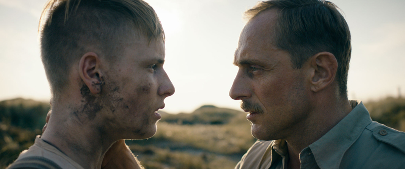 Actionbild Land of Mine (Danmark) - Louis Hofmann & Roland Møller
