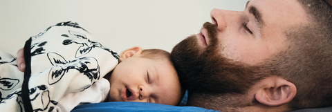 Man and baby asleep